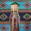 beans in a bottle, mexican rug background