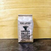 Fog Lifter Blend 1 lb brown bag on a dark surface and light wood background